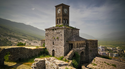 Panoramic view to Gjirokastra castle with the wall, tower and Clock, Gjirokaster, Albania