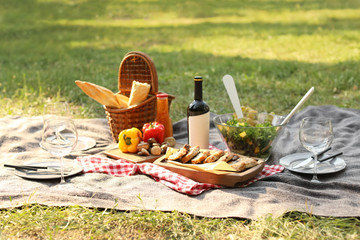 Zelfklevend Fotobehang Picknick Blanket with food prepared for summer picnic outdoors