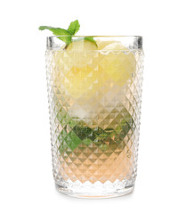 Glass with melon ball drink on white background