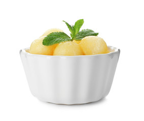 Bowl with melon balls on white background