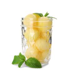 Jar with melon balls on white background