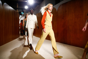 Models present creations at the ALEXACHUNG catwalk show at London Fashion Week Women's in London