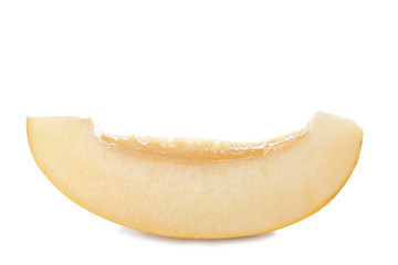 Slice of tasty ripe melon on white background