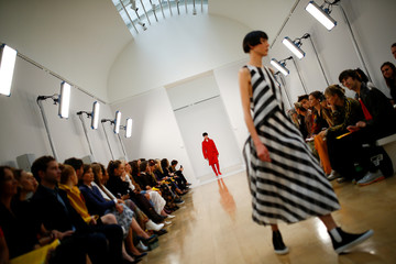Models present creations at the Jasper Conran catwalk show at London Fashion Week Women's in London