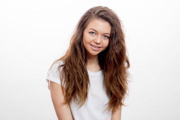 smiling dark-haired girl in the morning. close up portrait, issolated white background. studio shot. cheerful hipster girl in white t-shirt