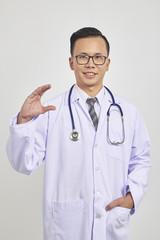 Asians doctor holding a digital tablet