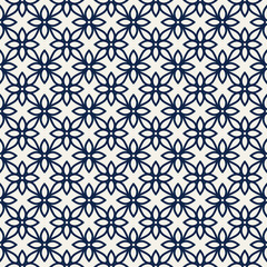 Woodblock printed indigo dye seamless ethnic all over floral pattern. Traditional oriental ornament of India Kashmir, geometric flowers motif, navy on blue ecru background. Textile design.