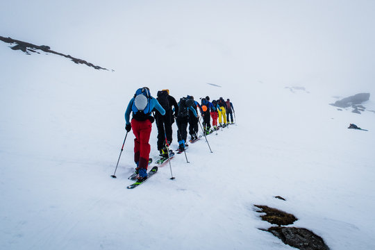 backcountry skiers ascending