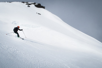 freeride skier on off piste mountain slope