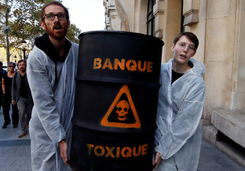 Anti-Globalization movement Attac activists protest in front of HSBC bank during an action to mark the 10th anniversary of the global financial crisis of 2008, in Paris