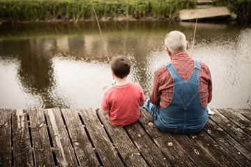 Happy Great Grandfather and Grandson Fishing Together