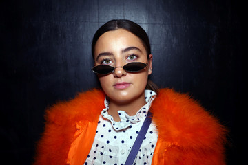 Fashion enthusiast Olivia Sorvel poses for a portrait during London Fashion Week in London