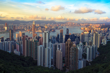 Hong Kong City Skyline seen from Peak on sunny Evening with Sunlight on Skyscrapers