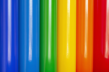 Background of rolls of colored vinyl film