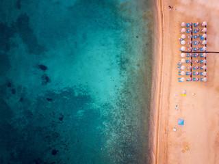 Aerial photo of a beach with beach umbrellas