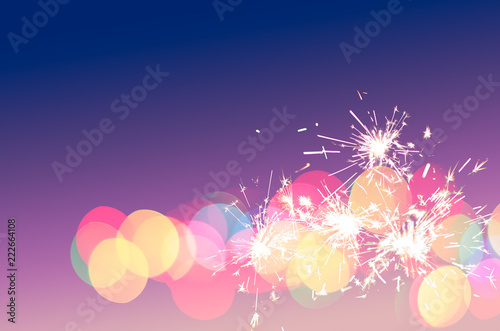 sparkler light colourful bokeh fun background for special party sweet love holiday festival