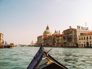 Gondola on the Grand Canal. Venetian lagoon. Historical architecture. Santa Maria della Salute. Venice, Italy