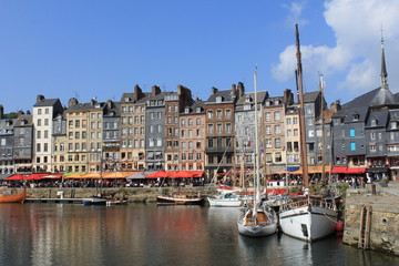 the famous fishing port in honfleur at a beautiful sunny summer day