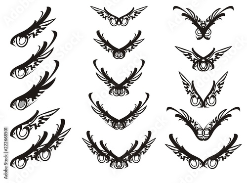 abstract eagle eye and tribal wings symbols tribal set of ornate