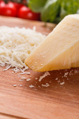fragrant grated Parmesan on a wooden slicing board