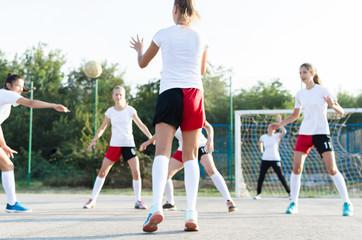 Female handball team playing