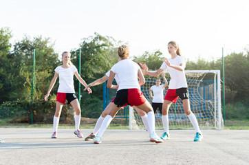 Female handball team playing a match