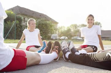 Female handball team taking break
