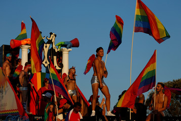 Participants ride on a float during the Malta Pride Parade in Valletta