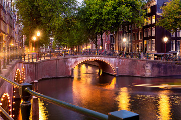 Wall Mural - Amsterdam evening with bridges, canals and lights at sunset