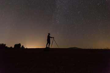 Photographer photographing stars