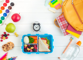 Foto op Textielframe Assortiment Open lunch box near clock, school accessories and backpack