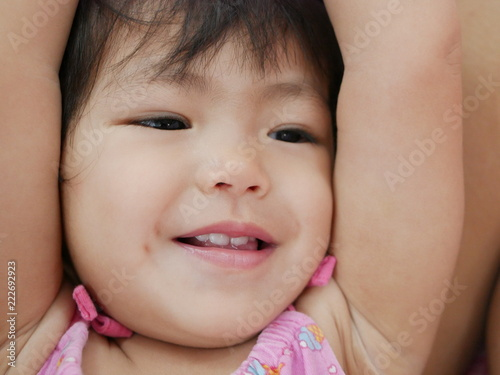 4f00a6ac989d Close up of happy smiling Asian baby girl s face