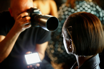 Models prepare backstage of the House of Holland show at London Fashion Week Women's  in London