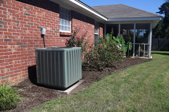 Air Conditioner system next to a home