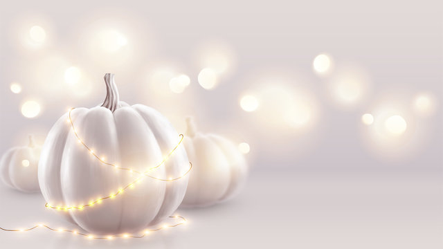 White realistic pumpkins and warm lights vector greeting card background. Halloween and wedding soft pink backdrop