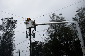 A worker restores the power lines after Hurricane Florence swept through the town of Kenansville, North Carolina