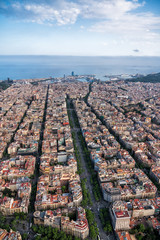 Aerial view of Barcelona main street and city skyline with blue sky, Spain