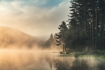 Morning fog on the lake, sunrise shot