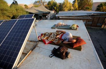 Activist protesting against Israel's plan to demolish the Palestinian Bedouin village of Khan al-Ahmar, sleeps in Khan al-Ahmar, in the occupied West Bank