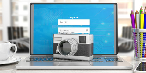 Retro camera, on computer, office background, 3d illustration.