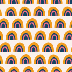 Abstract rainbows seamless vector pattern. Cute hand drawn rainbows orange, pink, and blue on white background. Scandinavian style. Great for kids market - fabric, paper, wallpaper, gift wrap, girl