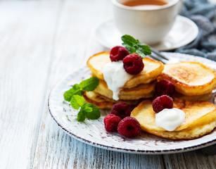 Delicious pancakes with raspberries