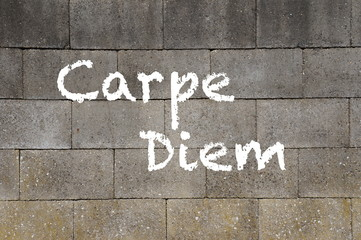 The words Carpe Diem, meaning Seize The Day, on a wall