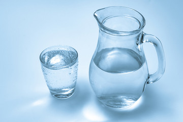 A glass of water and a jug