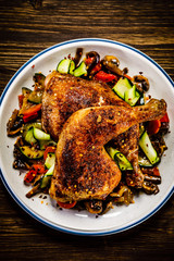 Barbecued chicken leg with vegetables