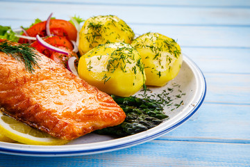 Grilled salmon with boiled potatoes, asparagus and vegetable salad