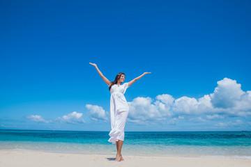 Woman in dress on beach