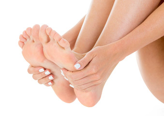 Woman cares about her feet. White background