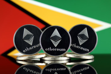 Physical version of Ethereum (ETH) and Guyana Flag. Conceptual image for investors in cryptocurrency, Blockchain Technology, Smart Contracts, Personal Tokens and Initial Coin Offering.