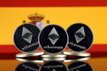 Physical version of Ethereum (ETH) and Spain Flag. Conceptual image for investors in cryptocurrency, Blockchain Technology, Smart Contracts, Personal Tokens and Initial Coin Offering.